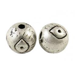 perle en métal type oeil